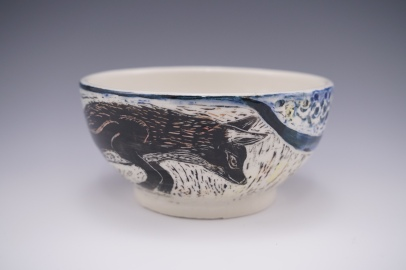 Porcelain bowl with colored slips and sgraffito design