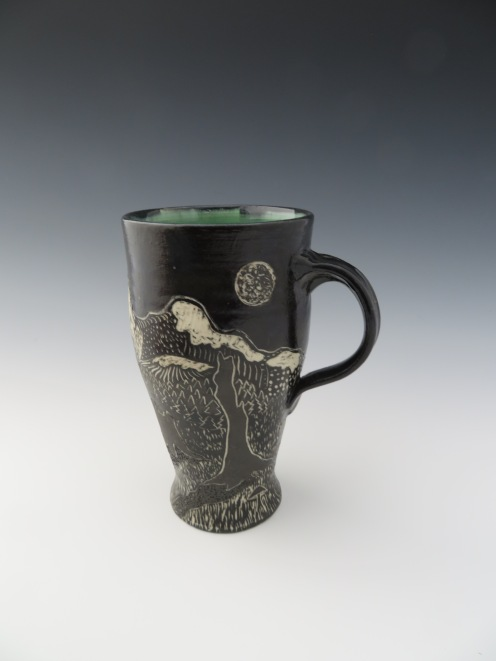 "Mountains & trees mug 6 3.5"" x 6 1/8"" $60"